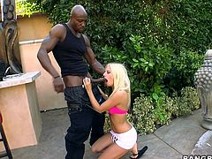 Watch this blonde teen cumming over and over in this hardcore interracial video where her tight pink pussy's penetrated by a monster black cock.