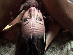 Amber Rayne is a really messy cock sucker. She gets very sloppy when this guy fucks her throat balls deep. She spits his cum on the camera and slurps it back in her mouth.
