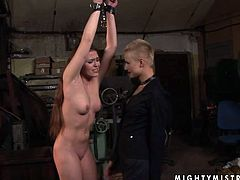 Kinky chick is always up for wicked porn scenes especially if it includes BDSM stuff. So she gets involved in this spicy scene. Her hands are tied up and lifted up in the air. Short-haired mistress caresses her body with a gun. This brings her sex slave much pleasure.