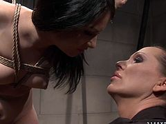 Frisky brunette amateur gets crucified by insatiable domina before she starts pulling her black hair and massaging her squeezed bandaged tits in BDSM-styled sex video by 21 Sextury.
