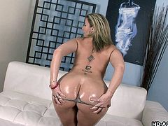 Sara Jay is a sexy blonde milf with a huge pair of boobs. She strips down naked to nothing but her thong. She shows off her big breasts and then pours some oil over her tits. Her black friend wants to give her a hand and pours some more oil on her while rubbing her boobs. This makes her extremely horny so know she wants to suck his big black cock.