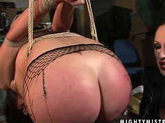 There's nothing she loves more than to punish her sex slaves. This cruel mistress wants to teach this redhead some good manners. She binds her slave in rope and now she's completely free to have her way with her sex slave.