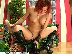 Brithney is a redheaded whore with huge and perfect tits. She rubs herself to let the juices flow out of her pussy and inserts a gigantic dildo inside. She squirts too.