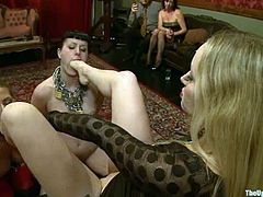 This is a hardcore lesbian fetish threesome. Two sassy sirens are being slaves and this blond with a huge strapon is their master for tonight!