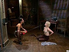 Ash Hollywood gets undressed and whipped by nasty Isis Love, the mistress. Later on the blonde girl gets toyed with a strap-on and an electric dildo.