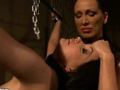 Insatiable big lipped domina suspends a mesmerizing amateur to slap her naked body with pressure before she sits on the floor in front of her to squeeze her tits in BDSM-styled sex video by 21 Sextury.