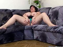 Watch this hot mature bbw stripping her clothes off and showing her big boobs on the couch.She is alone and horny so she spreads her legs and toys her big pussy with her favorite toy.