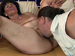 Insatiable young dude is a fan of chubby mature BBW. He goes down to a hairy pussy of one of them to tongue fuck it zealously before she squeezes his penis between her huge jugs to give a tit fuck.