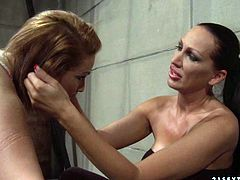 Rapacious brunette domina forces a submissive red-haired chic bend down to be able to slap her juicy ass with a lash until it gets red in peppering BDSM-styled sex video by 21 Sextury.