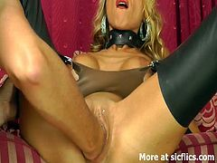This busty blonde is wearing latex stockings and heels. She gets her cunt fisted really deep and then she rides cock reverse cowgirl. This guy also penetrates her ass hole.