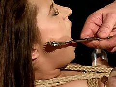 Dirty-minded dude ties up submissive brunette with ropes. He treats her tits with a breast pump and then fucks her soaking pussy from behind as tough as only possible for orgasm.