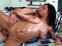 Superb brunette chick with big natural boobs gets oiled up. Then she sucks a cock and gives a titjob. Later on this whore gets fucked deep in her wet pussy.
