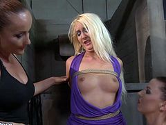 Kinky mistresses have got total domination over submissive blonde sex slave. They squeeze her tits rough. The mighty mistress also thrusts huge black dildo in her mouth stretching her lips.