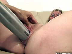 This brunette nymph knows how to make this woman groan with pleasure. She shoves a baseball bat inside her muff and starts pumping it in and out loosening up her once tight hole. Then she fists her pussy like mad.