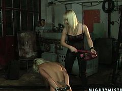 Filthy lesbian sex games including BDSM elements. Naughty blonde MILF is sitting down on her knees having her hands locked behind her back. Tough mistress hits submissive woman with whip.