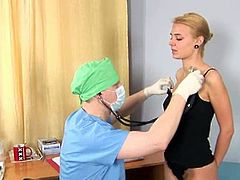 Watch a provocative blonde temptress taking her clothes off before her doctor stuffs a thermometer into her tight ass.