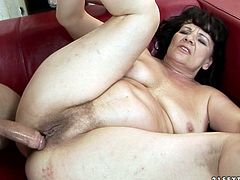 Immense brunette mature BBW lies in the sideways pose on the couch while a young insatiable fucked pokes her bearded vagina from behind before switching to missionary pose. Later he stretches her pussy lips with his fingers in sizzling hot sex video by 21 Sextury.