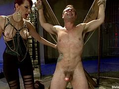 John Jammen and Maitresse Madeline are getting naughty in a basement. Maitresse binds John and then whips him with a lash and makes him eat her cunt.