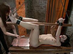 Elise Graves is having fun with Princess Donna Dolore indoors. Donna binds Elise and attaches leads to her tits. Then she rubs her clit with a dildo and smashes her pink cave with a toy.