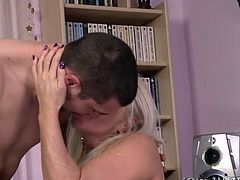 Whorish blond mature in nude lacy stockings gets her stretched shaved cunt pounded in missionary style by insatiable young fucker before she rides his sturdy cock reverse.