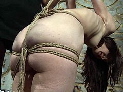 This insatiable brunette mistress is a master of tying young fresh faced chics. She bandages her slender body including small baggy tits in BDSM-involved sex video by 21 Sextury.