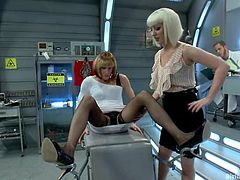Slutty blonde doctor Cherry Torn is having fun with Wolf Hudson indoors. She dresses him as a bitch and then lies down on the dude and gets fucked by some other guy.