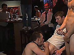 The bar is full of horny gays and Kirk Cummings is the attraction then crowd holds Kirk down as he endures the flogger then anal fucked on table