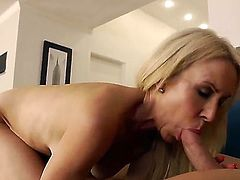Slim mature blonde cougar Erica Lauren with firm tits and cheep heavy make up gets hairy twat pounded balls deep by young Johnny Castle with muscled body and long stiff sausage.