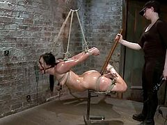 This lusty and slender hottie Ashli Orion gets suspended in a bondage and she has no way to escape from the fetishism of her master. Such a steaming BDSM!