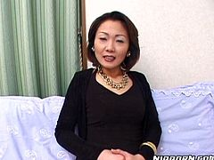 Strict looking Japanese mature Meyko has got a hot temperament. She sits on the couch wearing office wear before she starts getting undressed to unveil leopard-printed lingerie and fishnet stockings.
