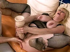 Chubby blonde with a nice pair of big boobs spreads her legs wide to let her lover drill her hairy snatch with huge dildo. Her pussy is pretty flexible and she likes getting one stretched over and over again.