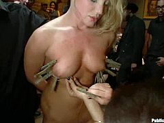 These people have an amazing party. One of their colleague gets undressed and tied up. Later on she gets her pussy toyed and fucked in the eyes of the whole staff.