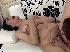 Straight haired brunette eats the soaking mature cunt on the couch