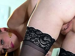 Incredible blonde blue eyed goddess Stacie Jaxxx  shows her sexy black stockings and plump milky white tits while gently stroking her angelic pussy.
