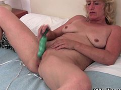 This blonde milf, Terry is still attractive considering her age. She enlarges her pussy with her fingers and then she inserts a vibrator in her cunt.