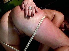Curvy brunette doxy gets suspended before a pitiless domina commands her lie on the floor in order to be able to poke her dirty mouth with dildo in BDSM-styled sex video by 21 Sextury.