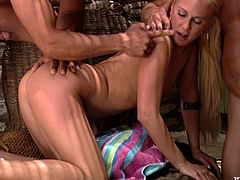 Slim blonde girl in bikini sucks a dick and rides another one at the same time. But that is not enough for her. So, then she gets double penetrated.