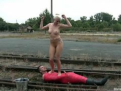 Nasty Lorelei Lee toys the guy on the railroad