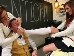 Jodi Taylor and Maddy O'Reilly are two lovely teens in school uniform. They give skillful footjob to Mark Wood in a classroom. Then they get fucked hard on a table.