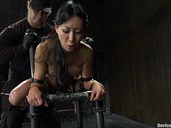 This amazing Asian babe gets bent over on that device, having her nipples twitched. Her mistress Isis Love loves Asian pussies like Tia LIng!
