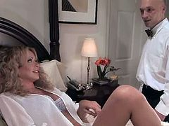 Blonde shemale Gia Darling is having fun with Troy in a bedroom. They fondle each other and then Troy gets his ass fucked in missionary position.