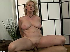 Aroused blond mom hops on sturdy cock of insatiable young lover reverse cowgirl style before she turns around to continue her ride in cowgirl position.