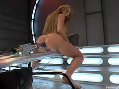 Long-haired blonde Amy Brooke is having some good time with her new toys. She shows off her amazing body and then gets her vag pounded hard and her butt double penetrated by the fucking machine.