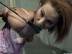 Foxy red-haired cutie gets her hand tied with a rope before an insatiable brunette domina takes a lash to slap her perky ass in BDSM-involved sex video by 21 Sextury.