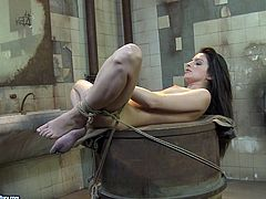 This hot mistress with big tits wants to teach her slave some good manners. She binds her in ropes and fingers her juicy pussy fervently.