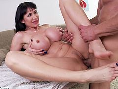 Busty brunette Eva Karera is getting naughty with some horny man indoors. She rubs his dick with her feet and then they bang in cowgirl positions and the man uses Eva's toes as a cum target.