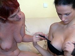 We love seeing our favorite nanny Henrietta in action! She's an old whore but doesn't keeps her away from having some good old fashioned lesbian fun! The brunette granny has her sweet girl and takes advantage of that young body. She puts the chick to suck a dildo and then gently spreads her pussy lips