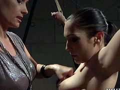 Mind taking brunette hottie gets crucified by voracious domina before she starts slamming her big round ass with a lash and later mauls it with pressure in steamy BDSM sex video by 21 Sextury.