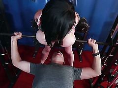 Cock hungry provocative big beautiful Christina Rhydes with colorful tattoos and long black nails teases handsome dude with gigantic natural tits and has fun with him all over the gym.