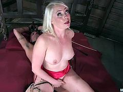 This stunning blonde mistress whips a guy and puts a stocking on his head. Later on she forces him to lick her pussy. After that she also rides his dick passionately.
